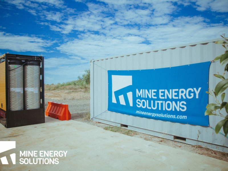 Mine Energy Solutions High Density Compressed Natural Gas HDCNG dual fuel pack next to MES branded container Thumbnail