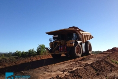 High Density Compressed Natural Gas HDCNG / diesel dual fuel conversion mine truck 473 driving down hill on mine site Thumbnail