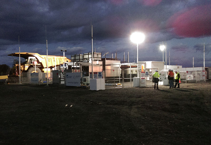 Onsite gas processing & refuelling facility at night